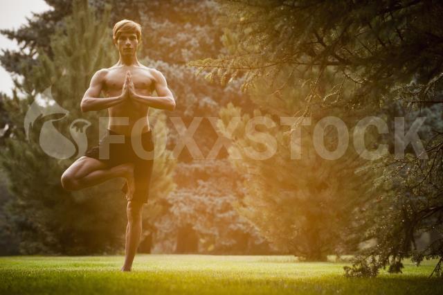 Bryson Thomson practicing yoga at Sugarhouse PArk in Salt Lake City, Utah.