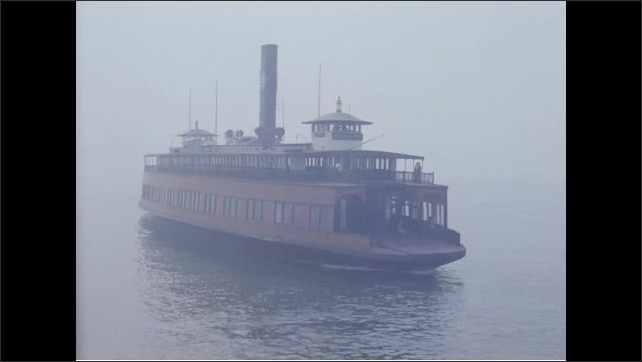 1960s: Ferry pulls away from dock. Ferry approaches dock where people wait to board.