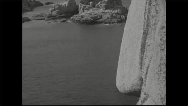 1940s: Rock formations.  Ocean.  Cliffs.