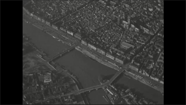 1940s: Barges pass by the city of Rouen on the river Seine. Aerial view of cathedral in the city of Rouen.