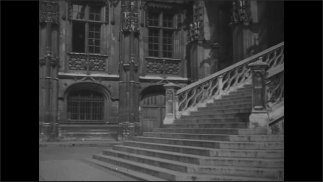 1940s: Columns stand in the inner courtyard of the Normandy Parliament building in Rouen. Stairs lead up to gothic government building.