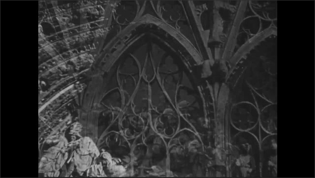 1940s: Statues of saints line the walls of Notre Dame Cathedral of Rouen. Spires and sculptures stand on the façade of ornate cathedral.