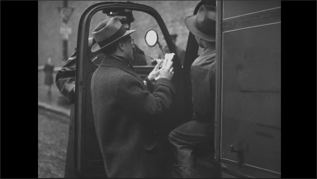 1940s: Police officer talks to man in truck, officer holds door open, man in truck leans out as other man approaches, driver hands man papers to look over. Man inspects meat on hooks in cooler.