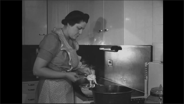 1940s: Woman in kitchen mixes batter in bowl on counter then drops batter into pot on stove. Man behind counter in butcher shop smiles.