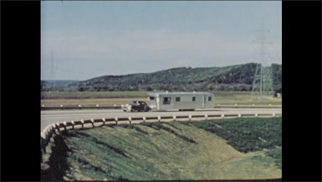 1950s: Folksy male narrator describes traveling lifestyle as he tows chrome mobile home down highway.