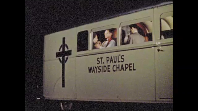 1950s: Man embraces Christianity, asking to be baptized in mobile church on wheels.