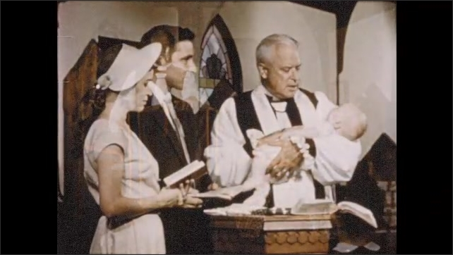 1950s: Congregation sits in rapt attention to the priest at church service; bishop performs baptismal, confirmation ceremonies