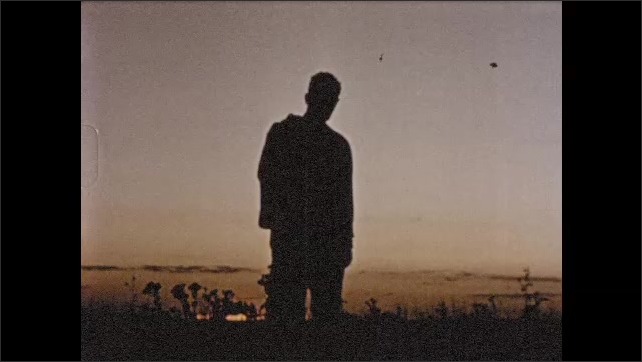 1950s: Clergymen reflects on his commitment to community of Salina Kansas, prays for guidance as sun sets on horizon.