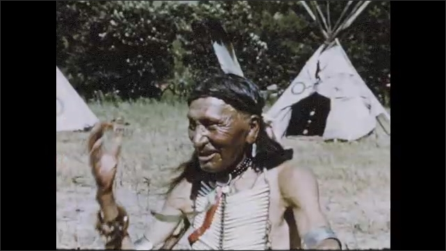 1950s: Sioux Indian approaches chief on horseback, bringing news of war.