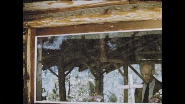 1950s: Elderly bishop enters rustic cabin, reflecting on God's purpose.