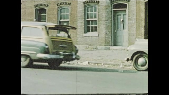 1950s: Car driver slams on brakes to avoid boy in city street; narrator reflects on youthful roots in city.