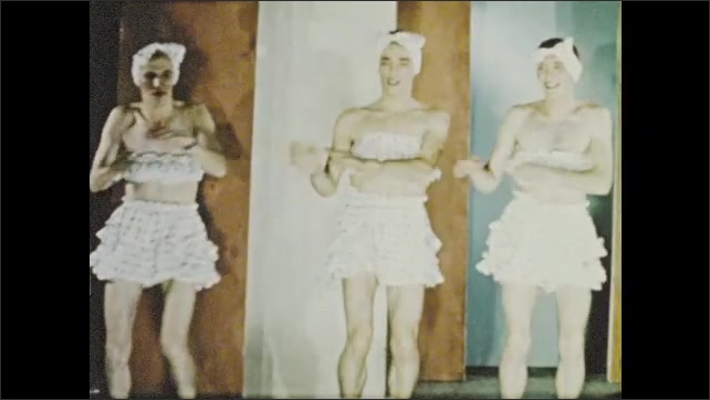 1950s: Top-hatted boy introduces trio of men in drag at community center play.