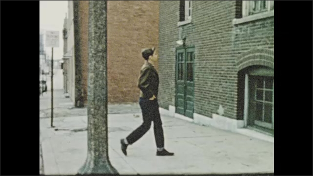 1950s: Troubled teen stands under street lamp, reflects on god's love, resolves to make amends for wrongdoing; youth slips card under door, rings doorbell.
