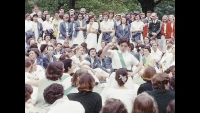 1950s: Smiling Bryn Mawr students sit on lawn singing and laughing; young woman conducts large group singing in front of crowds.