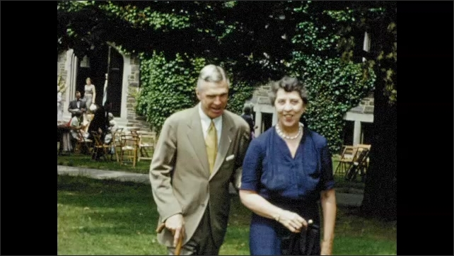 1950s: Well dressed family members enjoy luncheon on lawn at Bryn Mawr graduation celebration.