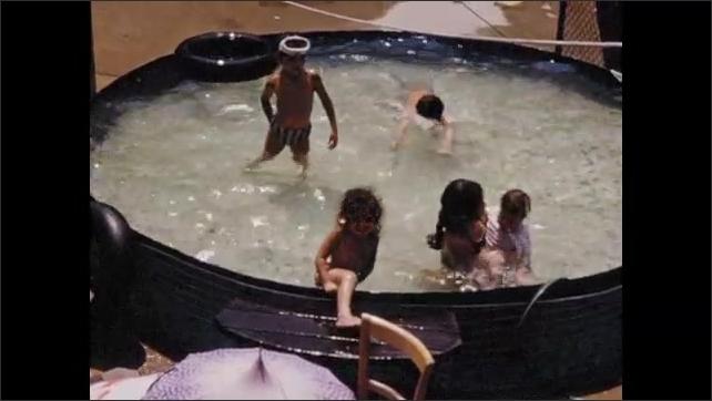 1960s: Children swim, play in pool in yard.