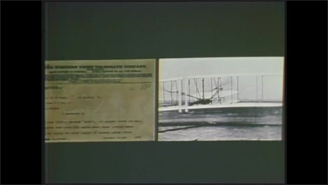 1970s: View of signatures on document. Dissolve, split screen, photo of telegram next to image of Wright brothers' plane. Dissolve, picture-in-picture, people pulling airplane.