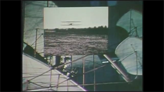 1970s: Picture-in-picture, footage of Wright brothers' plane over shots of plane in museum.