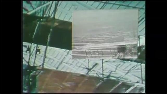 1970s: Picture-in-picture, footage of early planes flying over shots of Wright brothers' plane in museum.