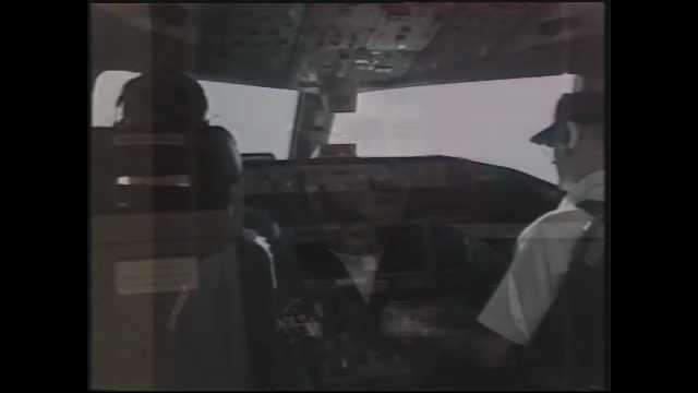 1990s: Plane cockpit, pilots adjust knobs. Sky, clouds, Boeing 757 plane flies. Plane interior, passengers sit, walk in aisles. Bank of dark clouds.