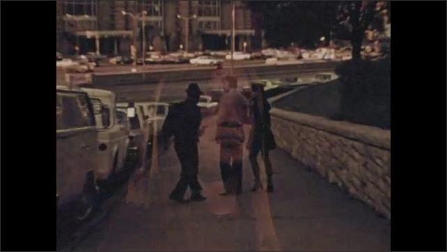 1970s: Man speaks. Woman speaks. Man robs couple. Woman screams.