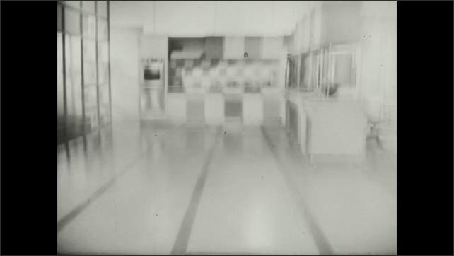 1960s: Tube of mentholatum deep healing rub in box, words. Bottle of Klear floor wax. Waxed floor in kitchen, living room, words. Bottle of Klear floor wax.