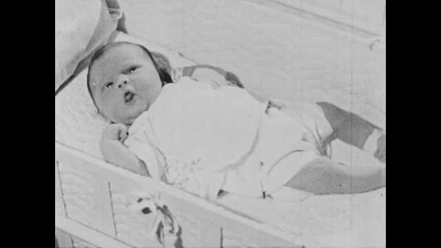 1950s: Baby lays in isolette and wiggles and cries.