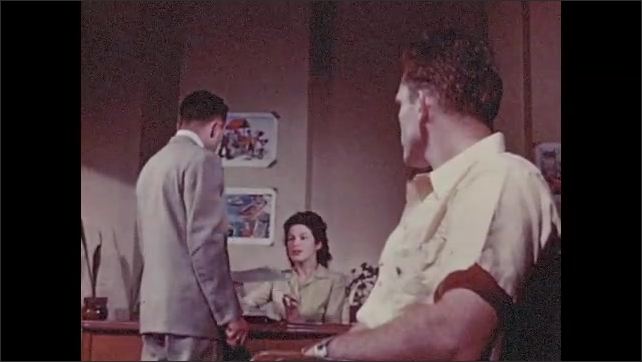 1950s: Man with crutches sits down in waiting room, talks to man sitting next to him. Man enters room, takes paper from secretary, escorts woman into another office.