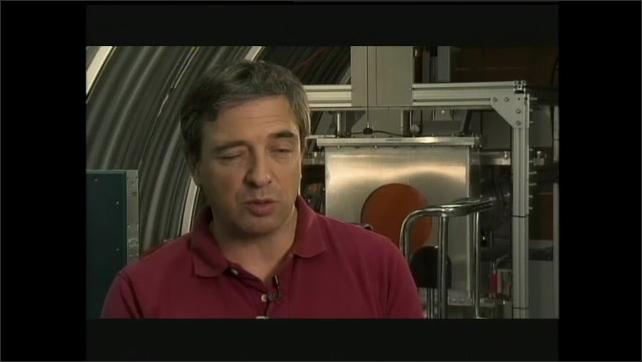 1990s: Computer animation, rocket pushing satellite through space. Nebula.