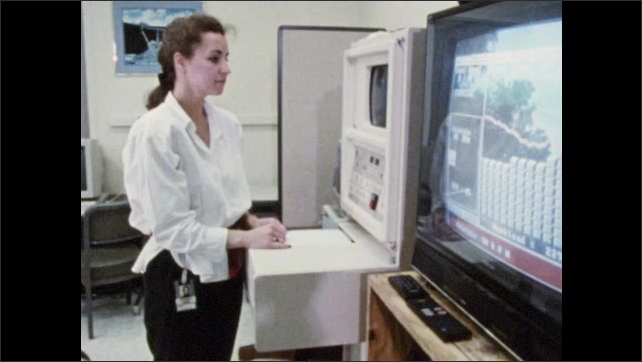 1980s: Women monitor computers and equipment as man walks on treadmill in lab. Man wears monitor wires and breathing apparatus and walks on treadmill.