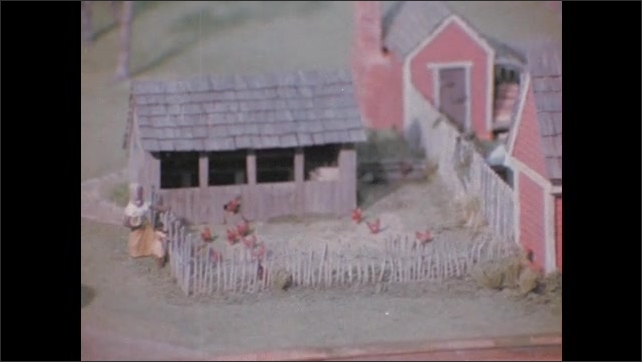 1970s: Woman uses spinning wheel. Thread on spinning wheel. Fruit on trees in garden. Miniature models on people and animals on farm. Building on property.