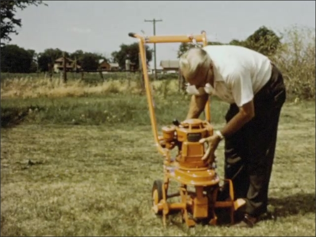 1960s: Man pushes down edging accessory on yellow lawnmower. Elderly man attaches rototiller accessory to mower base. Spinning blades of rototiller.