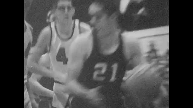 1960s: Basketball game. Score on board. Cheerleaders. People watching game shout. Basketball game. Cheerleaders. Basketball game. Ball goes in basket.