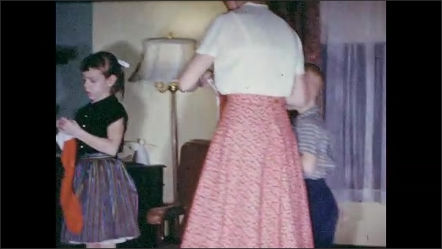 1950s, color, home, movie, ephemera, family, memories, nostalgia, vintage, family, children,church, parked, car, Christmas, season, stockings, fireplace, mantle, hang, Mother