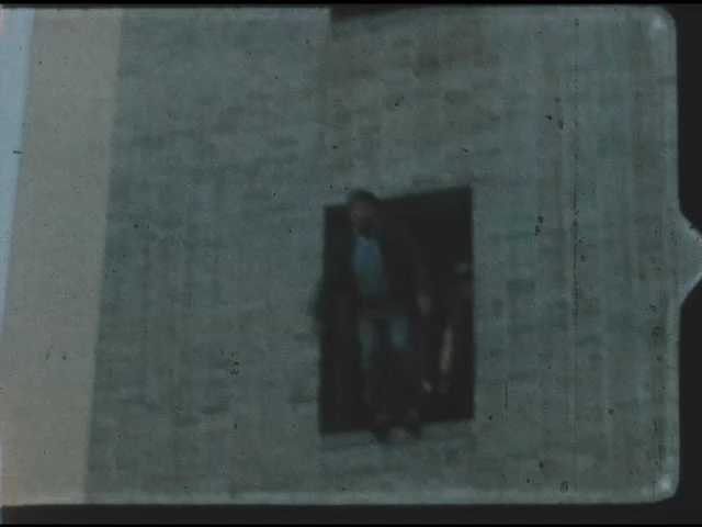 1960s: Shots of men jumping out of building into safety net.