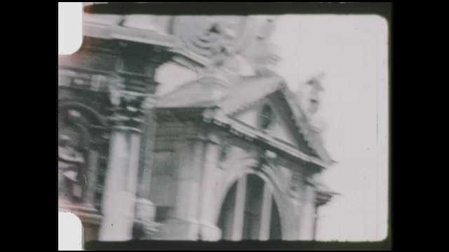 1950s Brussels: Tour boat floats past ornate architecture in city of Brussels.
