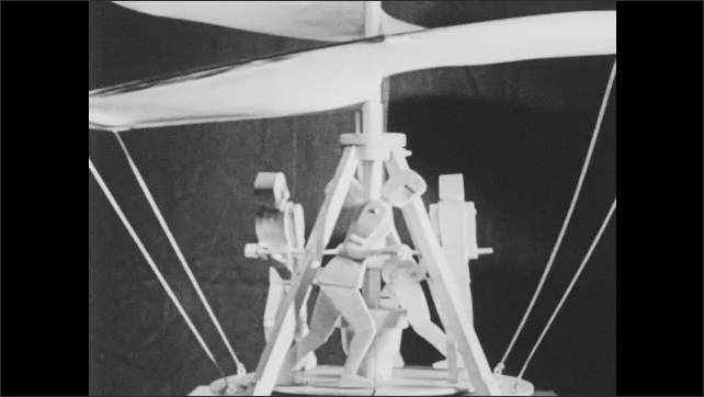 1960s: Model of early airplane designed by Leonardo DaVinci. Model of aerial screw designed by DaVinci. Wright brother's airplane. Wright brothers and airplane.