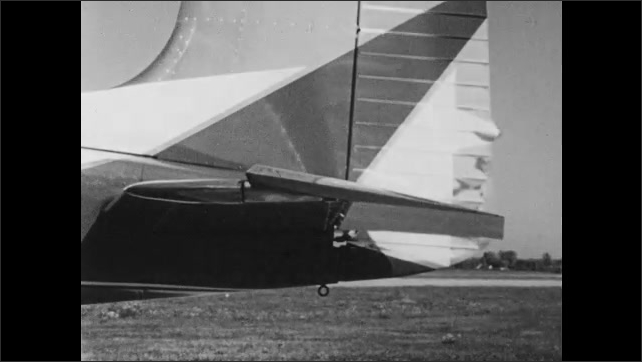 1960s: Person in cockpit of airplane pulls back on steering wheel. Elevators on tail move. Airplane in flight, changes altitude.