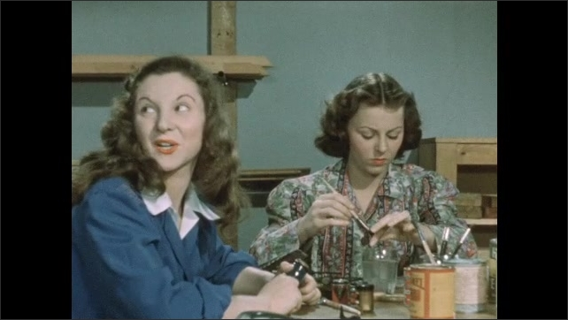 1950s: In art classroom, boy unpacks several items from box. Other teen girls paint objects at table. Teen boy enters room and speaks to the other teens.