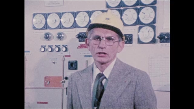 1970s: Man talking next to solar panel. Man talking in front of control panel. Close up of man.