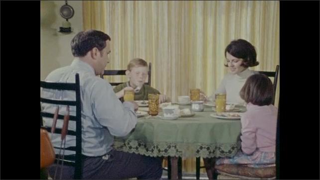 1970s: Primates jump in enclosure. Family eats.