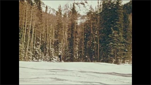 1970s: Lake next to houses. People ski on snow. Smoke erupts from volcano.