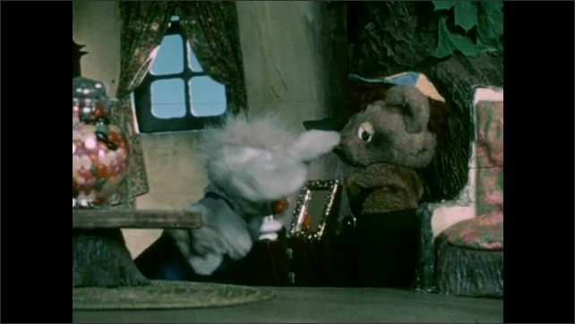 1970s: Puppets.  Tree house.  Mouse and bear speak near jar of jelly beans.  Animals run through house looking for something.
