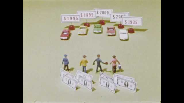 1970s: Model cars with price tags and model people with cash. Price tags on cars change. Several model people leave.