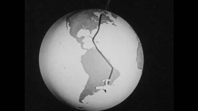 1950s: Model of airplane travels over globe of Earth. Snow covered land. Model airplane traveling over globe.