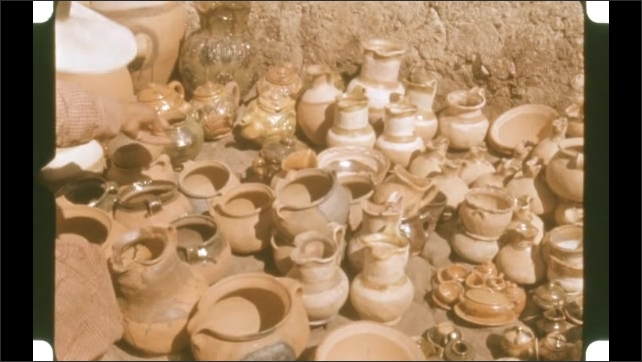 1950s: Woman sets out pottery.
