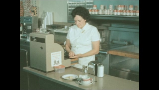 1950s: Postal worker pays for food at diner counter. Waitress counts money and puts it into cash register. Students carry artwork from school building and walk down sidewalk.