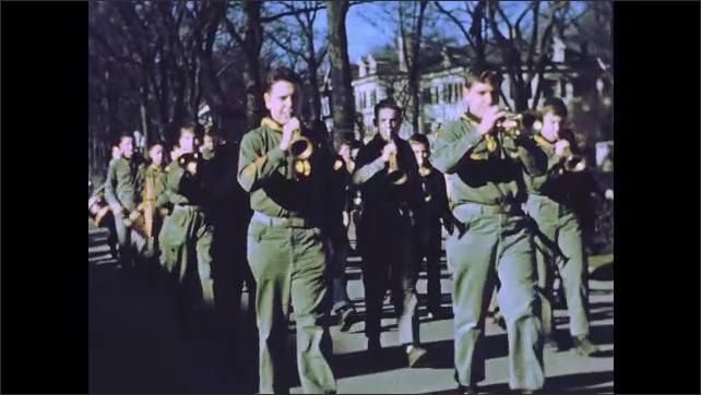 1950s: Parade.  Marching band.  Girls twirl batons.  Spectators.