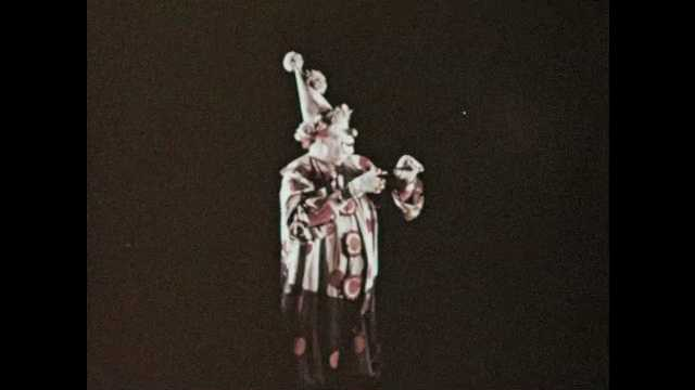 1950s: clown points to the left, backs up right, waves hands, picture of boy appears in the air, clown talks, laughs, points