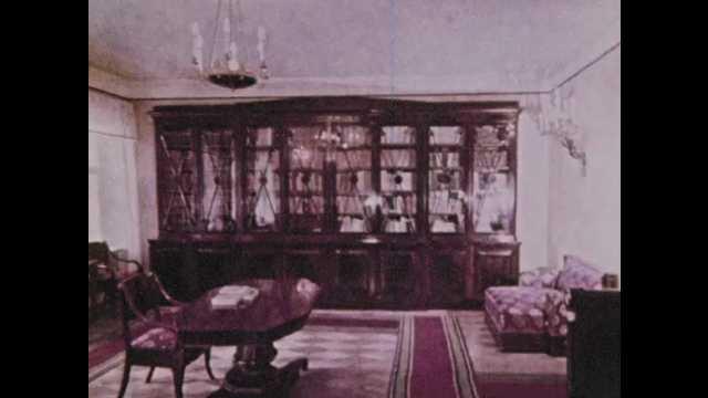 1970s Soviet Union: Interior of house. Antique desk and phone. Photograph of Lenin. Lenin's deathbed. Lenin's residence. Lenin's car in the garage.
